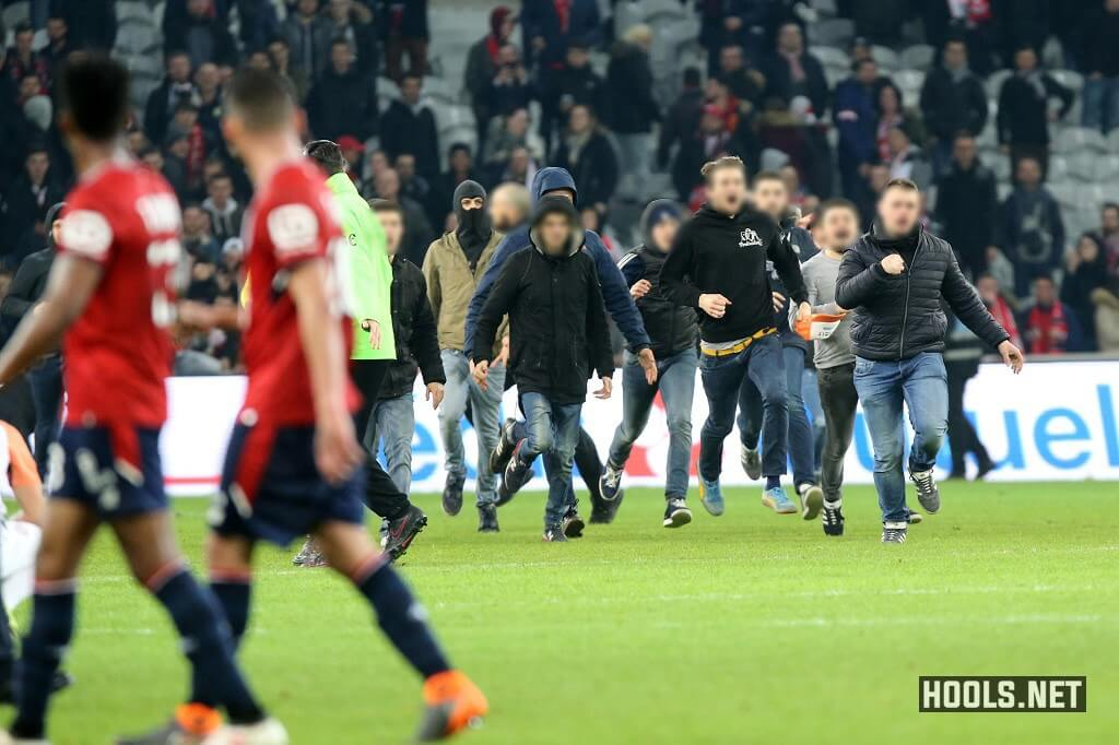 Lille fans invade the pitch at the end of the match