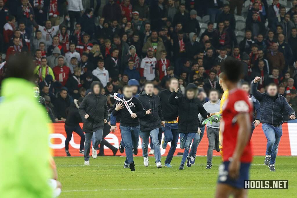Lille fans invade the pitch following their 1-1 draw against Montpellier