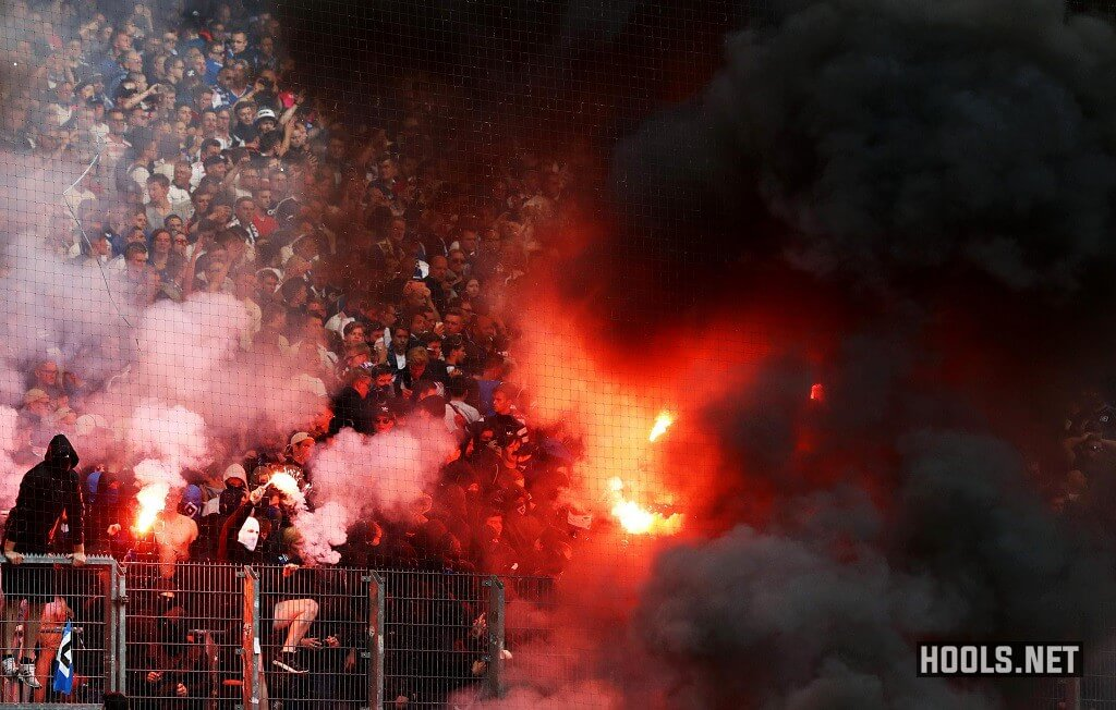 Hamburg fans light flares at the end of their Bundesliga match with Borussia Moenchengladbach