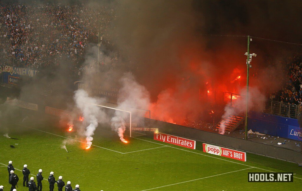 Hamburg fans throw flares onto the pitch at the end of the game