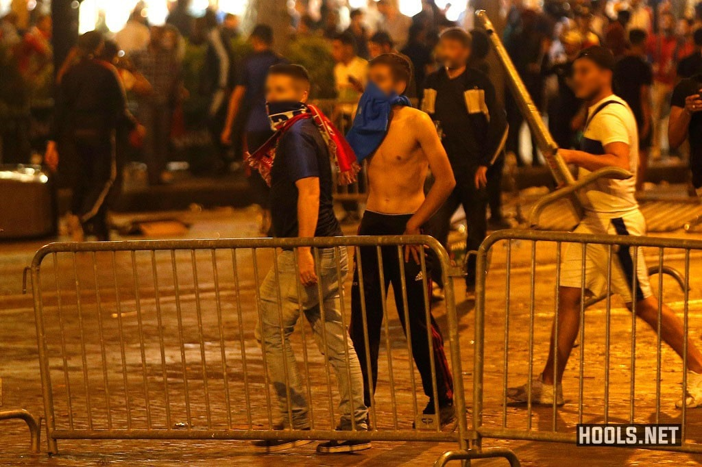 France fans clash with riot cops on the Champs Elysees after their World Cup semi-final match against Belgium.