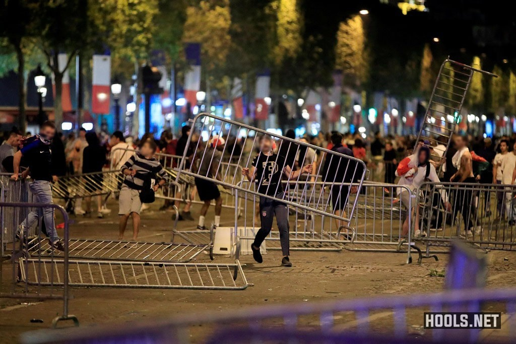 France fans with barriers clash on the Champs Elysees after their World Cup semi-final match.