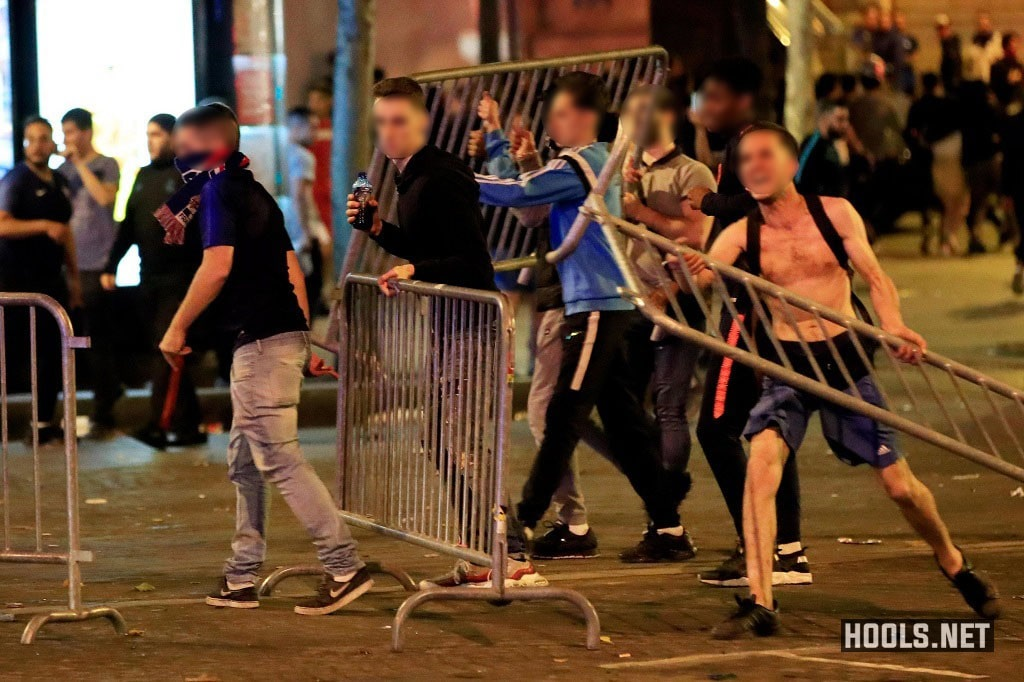 France fans with barriers clash on the Champs Elysees after their World Cup semi-final match against Belgium.