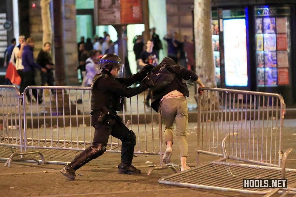 A French cop hits a fan during the clash.