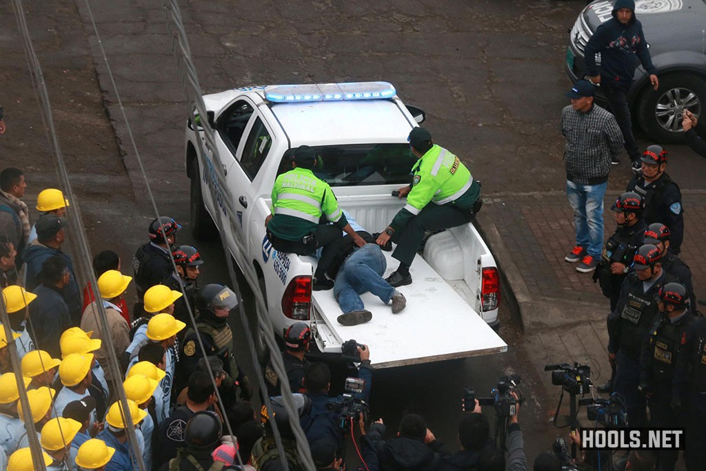 Police transport an injured man after the clash between Alianza Lima fans and evangelical Christians near the Alejandro Villanueva stadium.