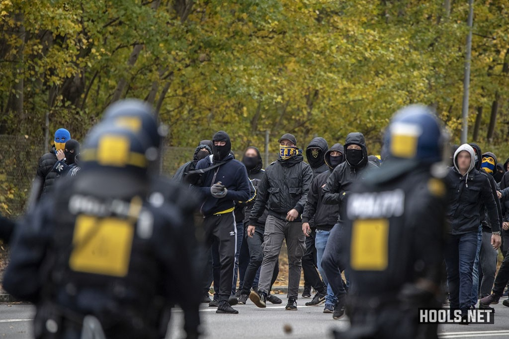 Brøndby hooligans clash with riot police after their match against FC Copenhagen.