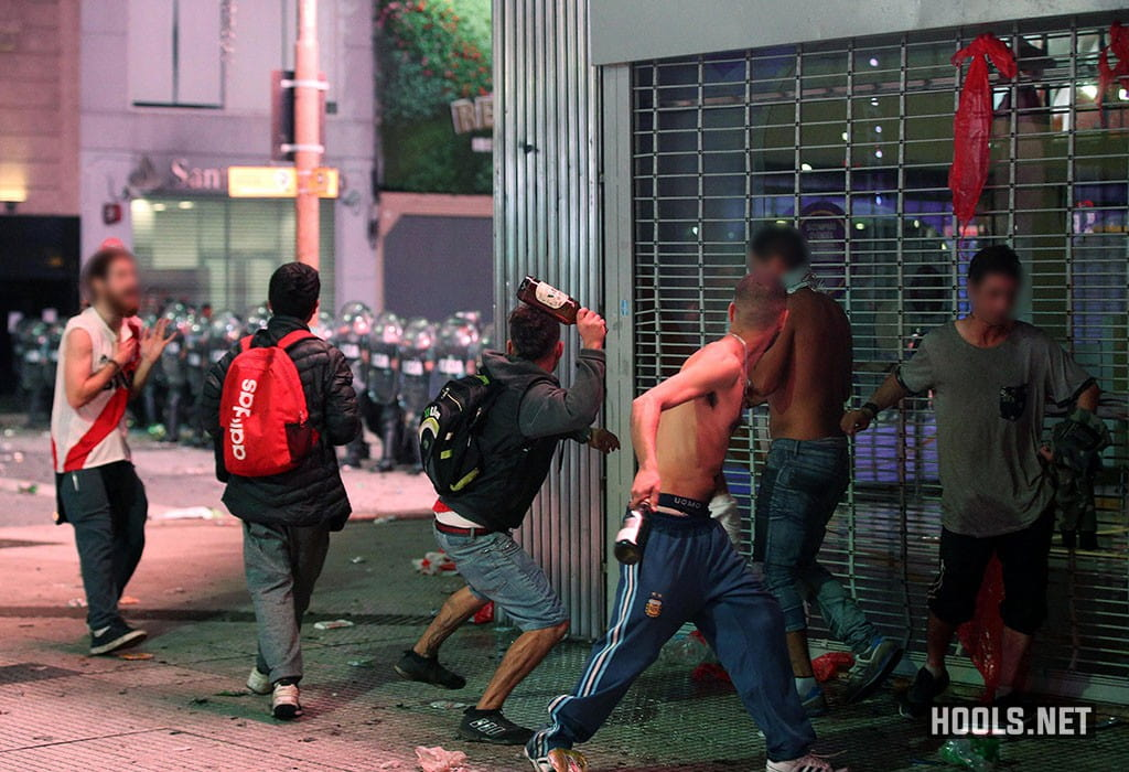 River Plate fans hurl bottles at riot police