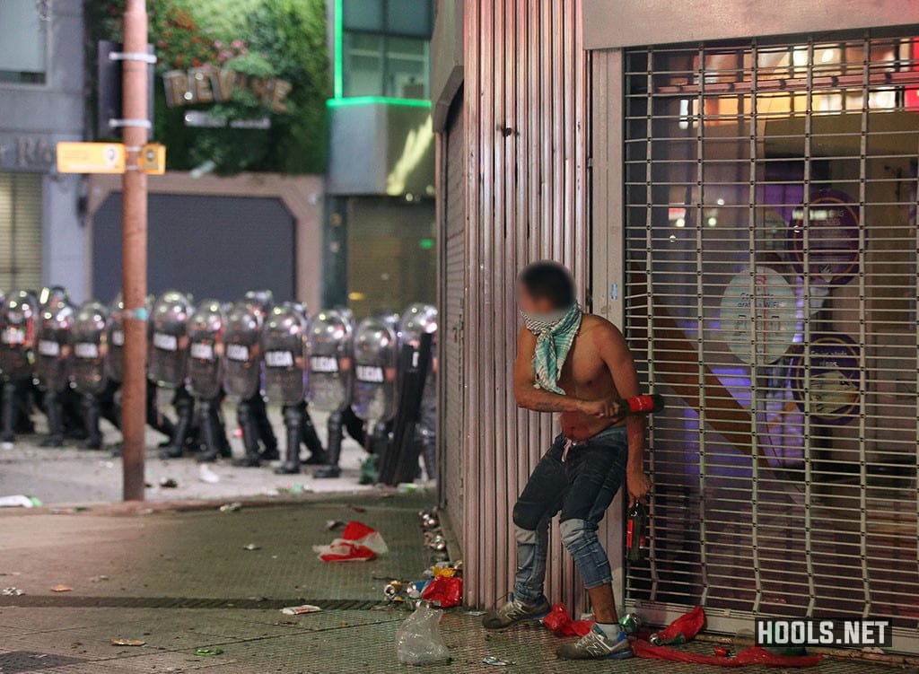 A River Plate fan during clashes with riot police in Buenos Aires