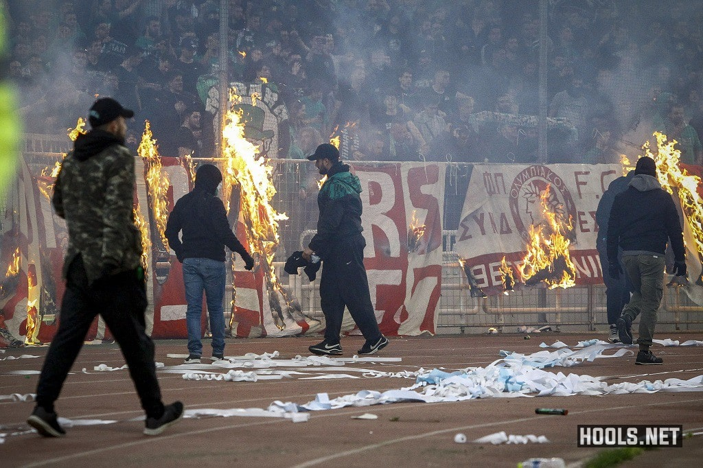 Panathinaikos hooligans set fire to banners during their derby against Olympiacos.