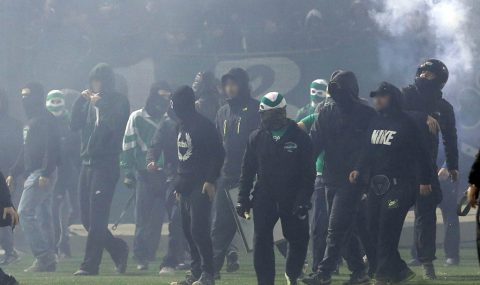 Panathinaikos hools clash with police after match called off