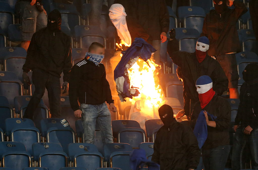Hansa Rostock hooligans set fire to a Hertha Berlin banner during their German Cup clash
