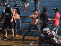 Olimpia fans fight each other during Sol de America game