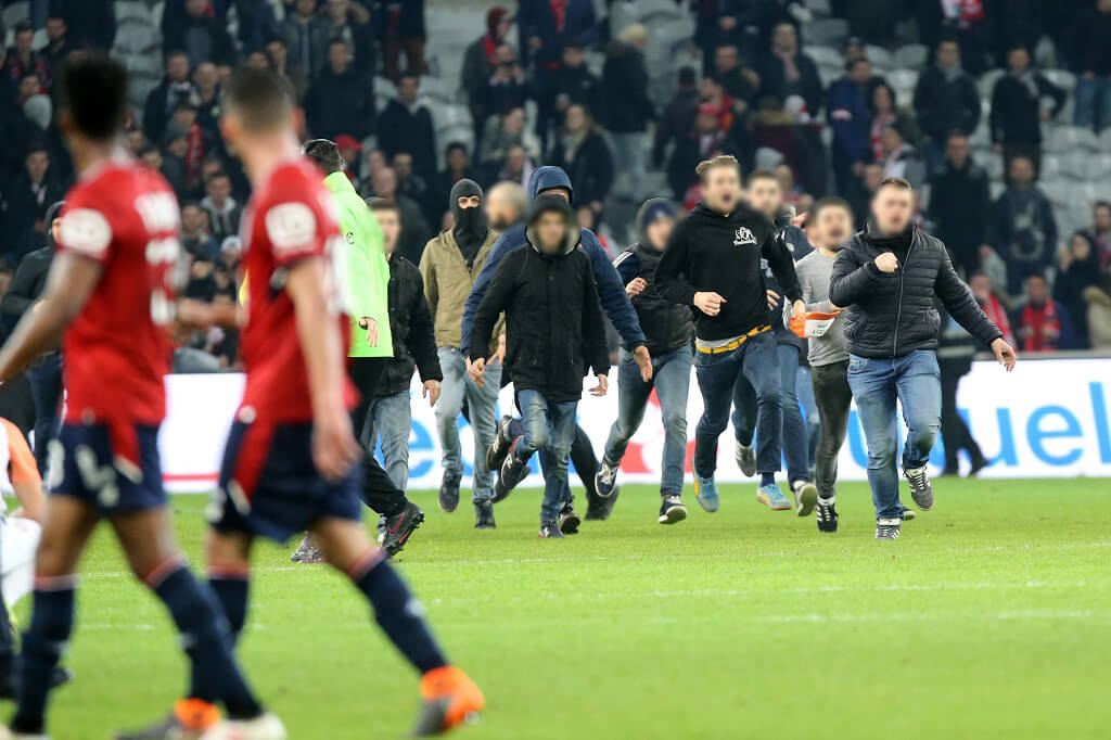 Lille fans invade the pitch