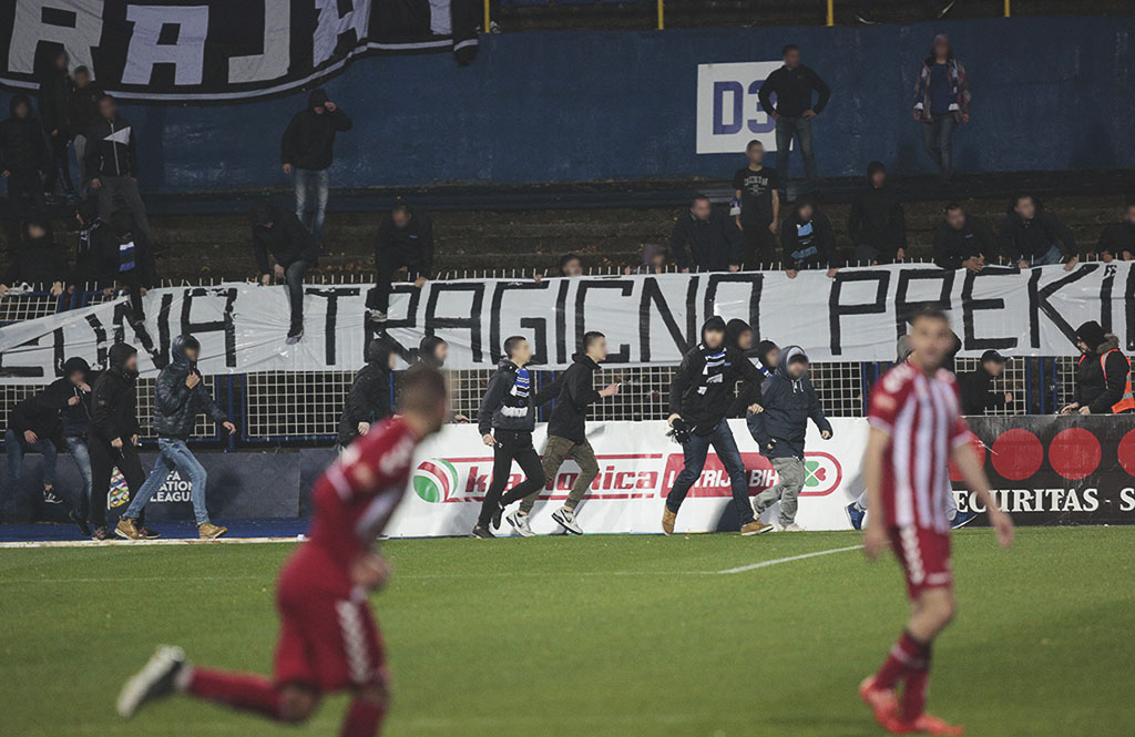 Angry Zeljeznicar fans storm the pitch after their 1-0 home defeat to Zvijezda 09.