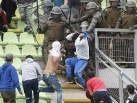 Santiago Wanderers fans fight each other during Cobresal game