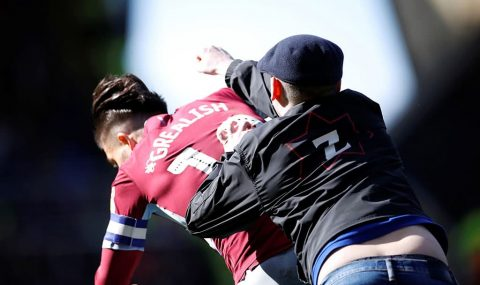 Aston Villa player attacked by fan during Birmingham derby