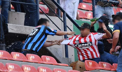 Fans fight in stands during Atletico San Luis v Queretaro match