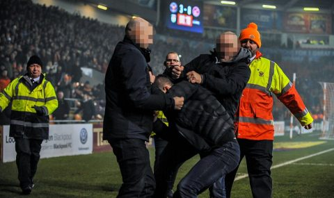 Blackpool fans punch Fleetwood supporter during League One match